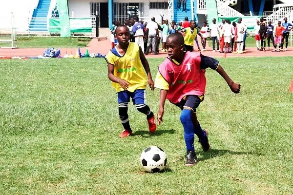 young players at the trials for the Safaricom next Generation program. Image from http://www.hapakenya.com/2015/11/20/the-safaricoms-next-generation-football-national-trials-kick-off/