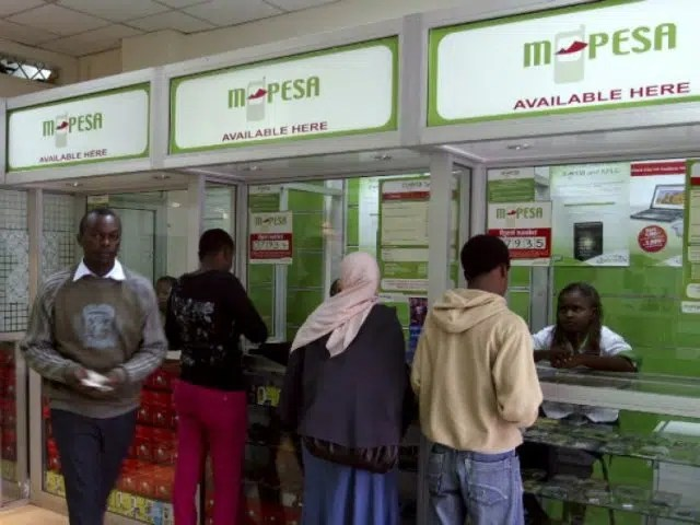 People depositing and withdrawing money at an Mpesa shop. Image from http://ow.ly/ZkvxA