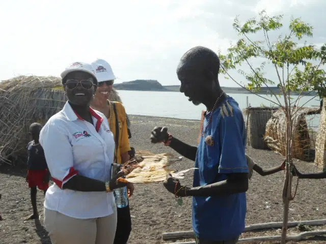 Jacinta Nzioka - Mbithi at the shores of Lake Turkana where she is learning about EL Molo food.