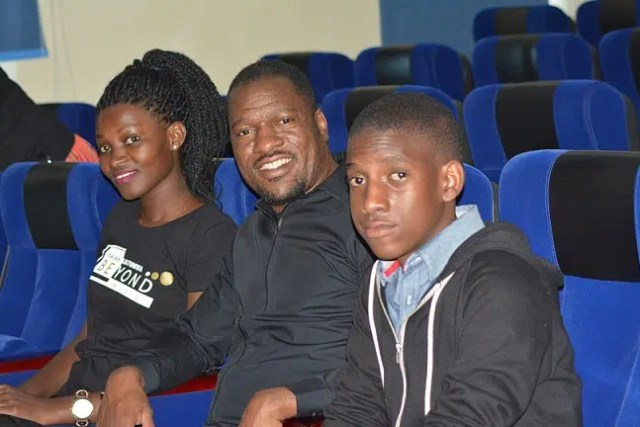 Isaiah Katumwa (middle) with his son Mitchell Katumwa