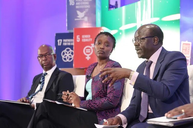 Secretary General of the United Nations Conference on Trade and Development (UNCTDA) Dr. Mukhisa Kituyi participates in a panel discussion on why and how should the private sector engage with the Sustainable Development Goals agenda during the launch of Safaricom's SDG Business Strategy. On the immediate left is Head of Public Private Dialogue at Kenya Private Sector Alliance(KEPSA) Agatha Juma and  Safaricom Limited Chief Executive Officer Bob Collymore. Photo courtesy of Safaricom.