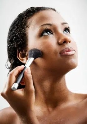 Woman applying foundation. Image from http://www.chicagonow.com/urbanity-beauty/2012/12/have-black-women-found-a-new-face-of-beauty-in-cosmetic-surgery/