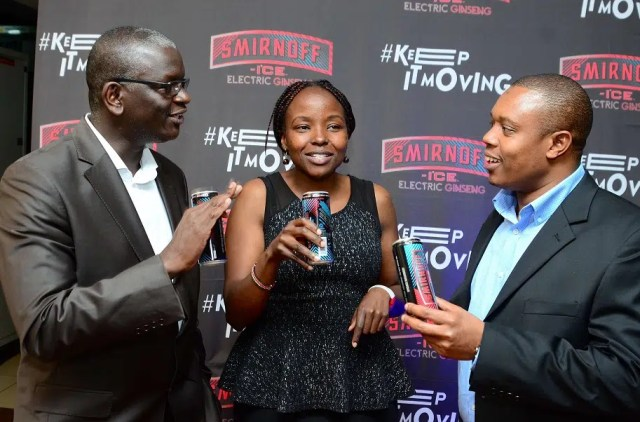 KBL Sales Director Andrew Kilonzo (left) KBL Senior Innovation Manager Effie Thiongo (center) and KBL Head of Innovation of Innovation Fred Otieno (right) have a feel of the new Smirnoff Ice Electric Ginseng during the its launch in Nairobi. The alcoholic beverage is targeted at male consumers in the country.