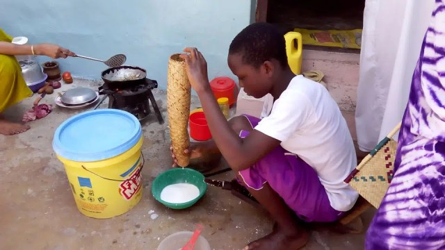 Young girl making coconut milk.