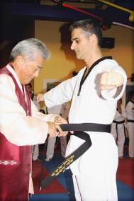 Receiving my 1st Dan from Grand Master Kim