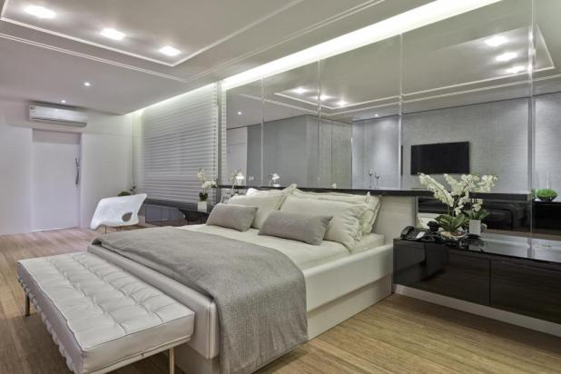 modern-interior-bedroom-design-with-white-headboard-and-beautiful-lighting-in-ceiling-as-well-wooden-floor-and-dark-wooden-vanity-under-the-rectangular-mirror-on-the-wall 5 Stylish Bedroom Designs For Your Comfort
