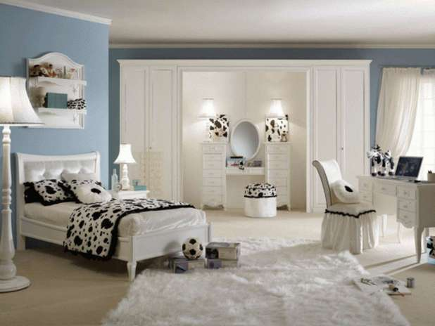 fancy-blue-wall-paint-color-background-with-black-and-white-cow-bedroom-theme-decor-plus-cream-area-rug-design 5 Stylish Bedroom Designs For Your Comfort