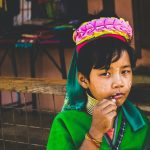 a child from the Padaung wearing his traditional coils