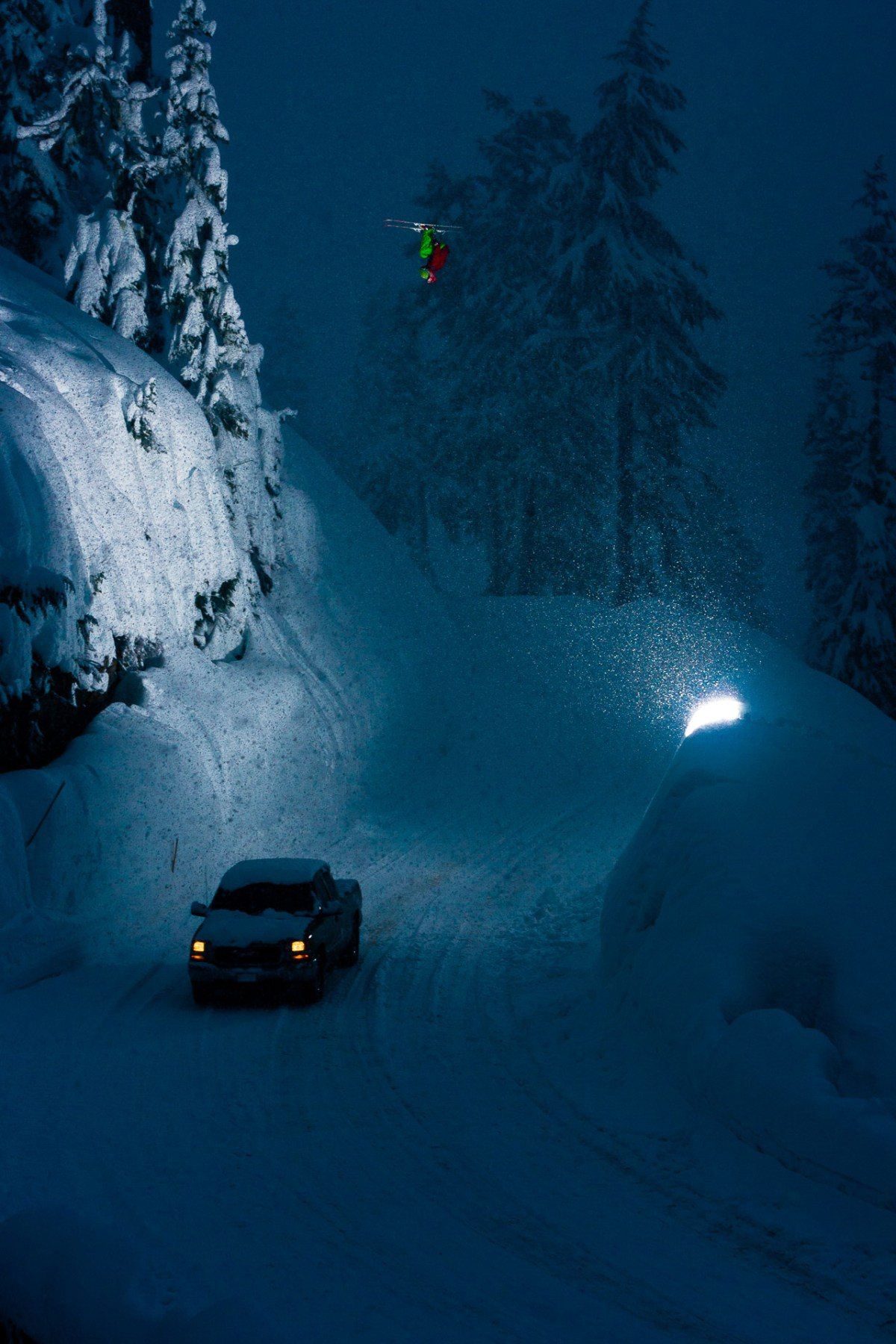 Dana Flahr throwing a very large lawn dart front flip over the Mt. Baker road gap at dusk while filming for TGR