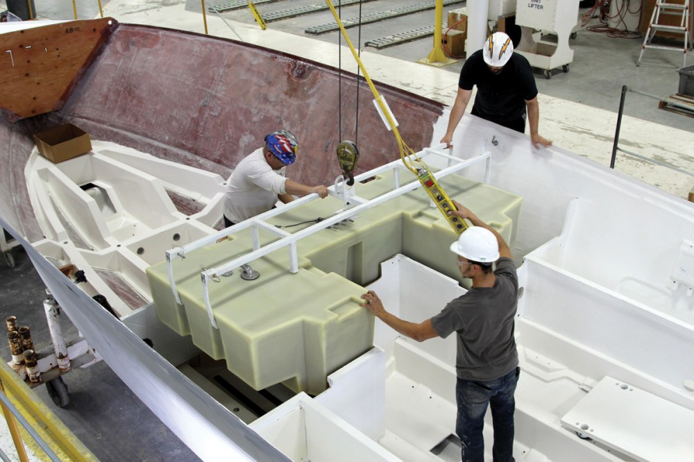 medium resolution of workers at tiara yachts install a plastic fuel tank in a new 38 ls
