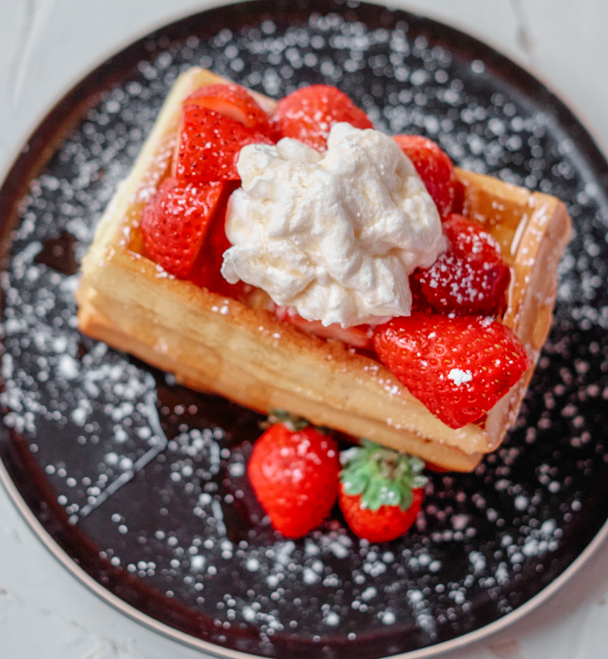 waffles with strawberries and whipped cream