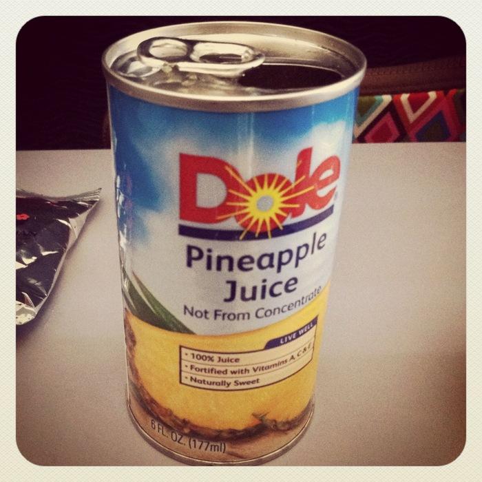 dole pineapple juice can Hawaiian Airlines flight to Hawaii