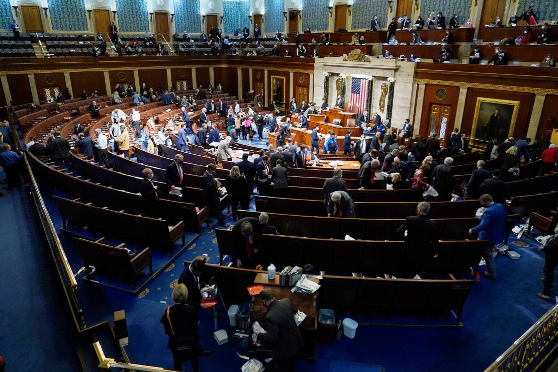 House members prepare to leave the floor as rioters try to break into the House Chamber at the U.S. Capitol on Wednesday.