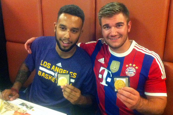 Sadler (left) and Skarlatos, holding medals they already have been awarded by the French