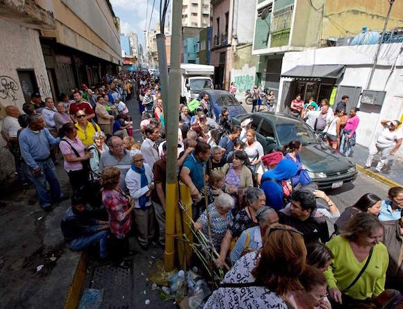 Venezuelans line up to buy price-controlled toilet paper