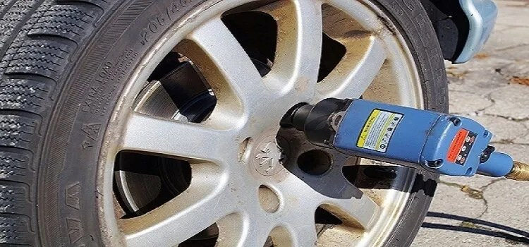 removing lug nuts from tires using impact wrench