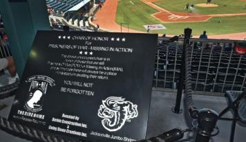 "A plaque commemorates the POW/MIA ""One Empty Chair"" installed behind home plate and dedicated Monday, Sept. 4, 2017, by the Jacksonville Jumbo Shrimp. (Bob Mack/Florida Times-Union)"