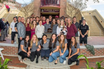 Members of the Speicher family gathered with the FSU Men's and Women's Tennis teams to unveil the memorial in honor of U.S. Navy war hero Scott Speicher, a 1980 FSU business administration graduate. (FSU Photography Services)