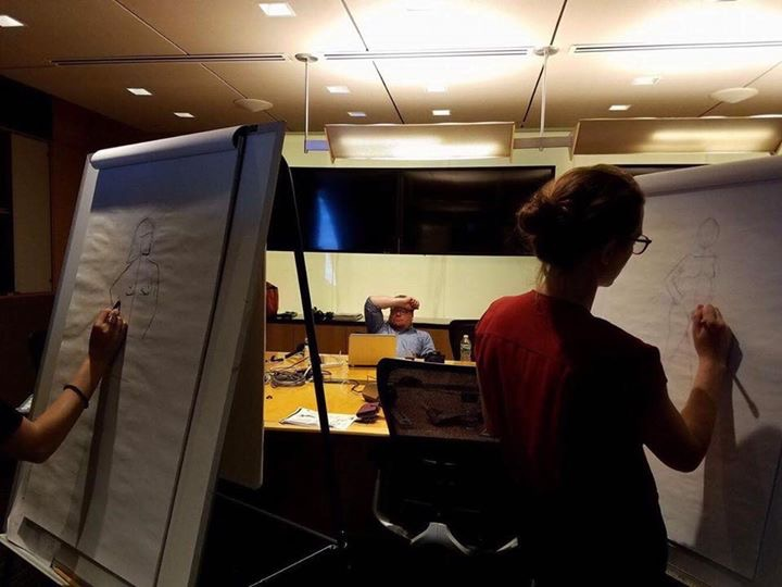 Journalists drawing the live model at Reuters. (Photo courtesy Janet Roberts)