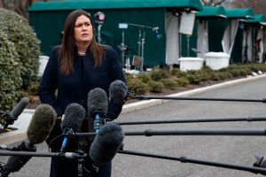 White House press secretary Sarah Huckabee Sanders listens to a question as she speaks with reporters outside the White House, Wednesday, Jan. 23, 2019, in Washington. (AP Photo/ Evan Vucci)