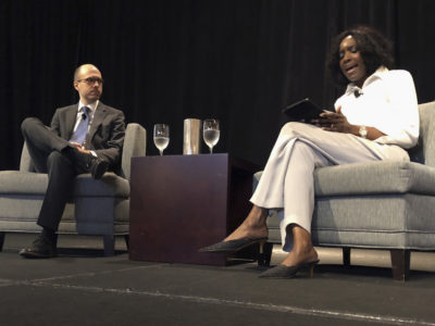 "New York Times publisher A.G. Sulzberger, left, and Nancy Ancrum, editorial page editor of the Miami Herald, address attendees at an Associated Press Managing Editors conference in Austin, Texas, in 2018. This week, Sulzberger condemned President Donald Trump's continued use of the phrase ""enemy of the people."" (AP Photo/Paul Weber)"