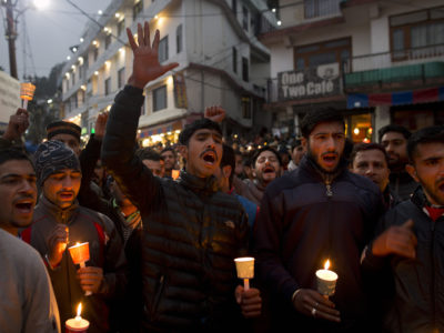 Local residents shout slogans as they participate in a candlelight vigil to mourn Indian paramilitary soldiers killed in Kashmir, in Dharmsala, India, Saturday, Feb. 16, 2019. (AP Photo/Ashwini Bhatia)