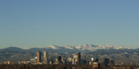 FILE - In this Jan. 24, 2016 file photo, the Rocky Mountains rise beyond the Denver skyline. (AP Photo/Charlie Riedel, File)