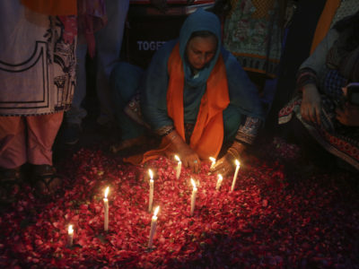 A Pakistani woman lights candles during a vigil for the victims of bomb explosions in churches and hotels in Sri Lanka, in Lahore, Pakistan, Tuesday April 23, 2019. (AP Photo/K.M. Chaudary)
