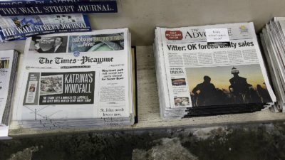 In this 2012 file photo, free introductory copies of The Advocate's New Orleans edition, right, are seen next to copies of The (New Orleans) Times-Picayune. (AP Photo/Gerald Herbert)