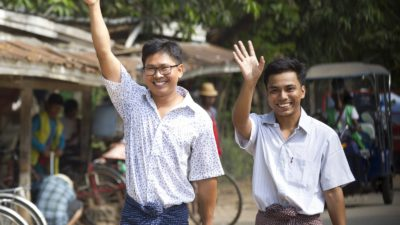 Reuters journalists Wa Lone, left, and Kyaw Soe Oo wave as they walk out from Insein Prison after being released in Yangon, Myanmar Tuesday, May 7, 2019. (AP Photo/Thein Zaw)