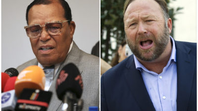 From left, minister Louis Farrakhan, the leader of the Nation of Islam,and conspiracy theorist Alex Jones. (AP Photo)
