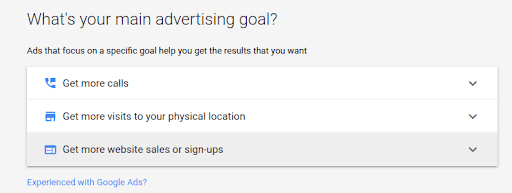 Google Ads setting screen for advertising goal selection choosing sales or sign-ups