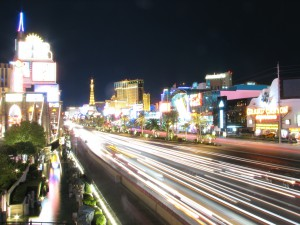 This is a nighttime picture of the Las Vegas strip, taken with a slow setting so the lights of the cars passing by seem like streams of light.