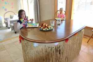 Table with grass skirt and flowers