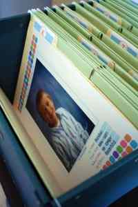 Hanging file with a folder for each grade in school