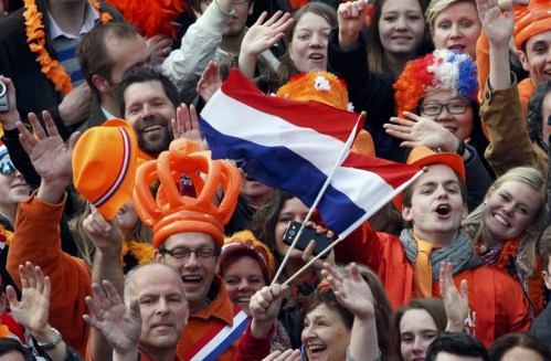 People celebrate the new Dutch King Willem-Alexander in Amsterdam's Dam Square