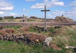 Cross and chapel on St Cuthbert's Isle looking towards Holy Island