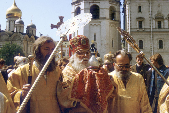 Bishop Basil carrying the Holy Fire.