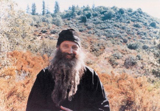 Fr. Seraphim in the St. Elias Skete, Noble Ridge, near the St. Herman of Alaska Monastery in Platina, Cal. In the background is Mt. St. Herman.