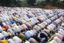 Muslims are prostrating during prayer.