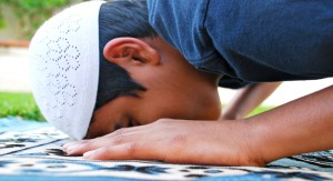A young boy is offering prayer.