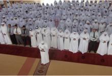 A group of Muslims offer prayer in congregation. Prayer Develops Unity