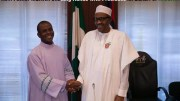 Rev. Fr. Mbaka shakes hands with President Buhari