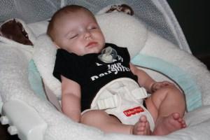 Newborn Baby Asleep in His Swing