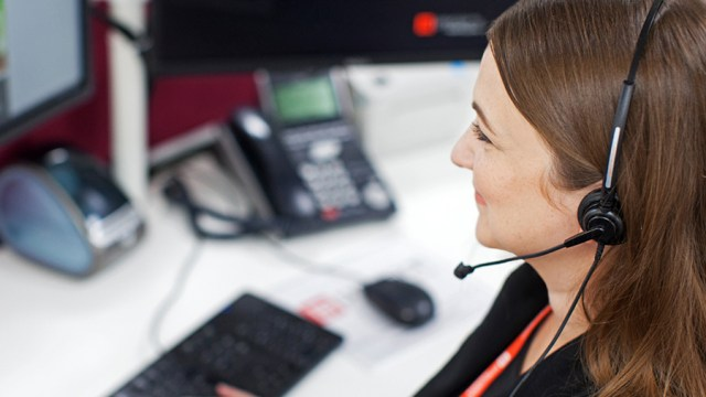 Customer support worker helping a client