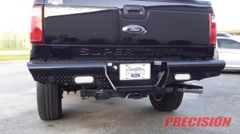LED backup lights and the stock backup sensors were fitted to the Ranch Hand rear bumper.
