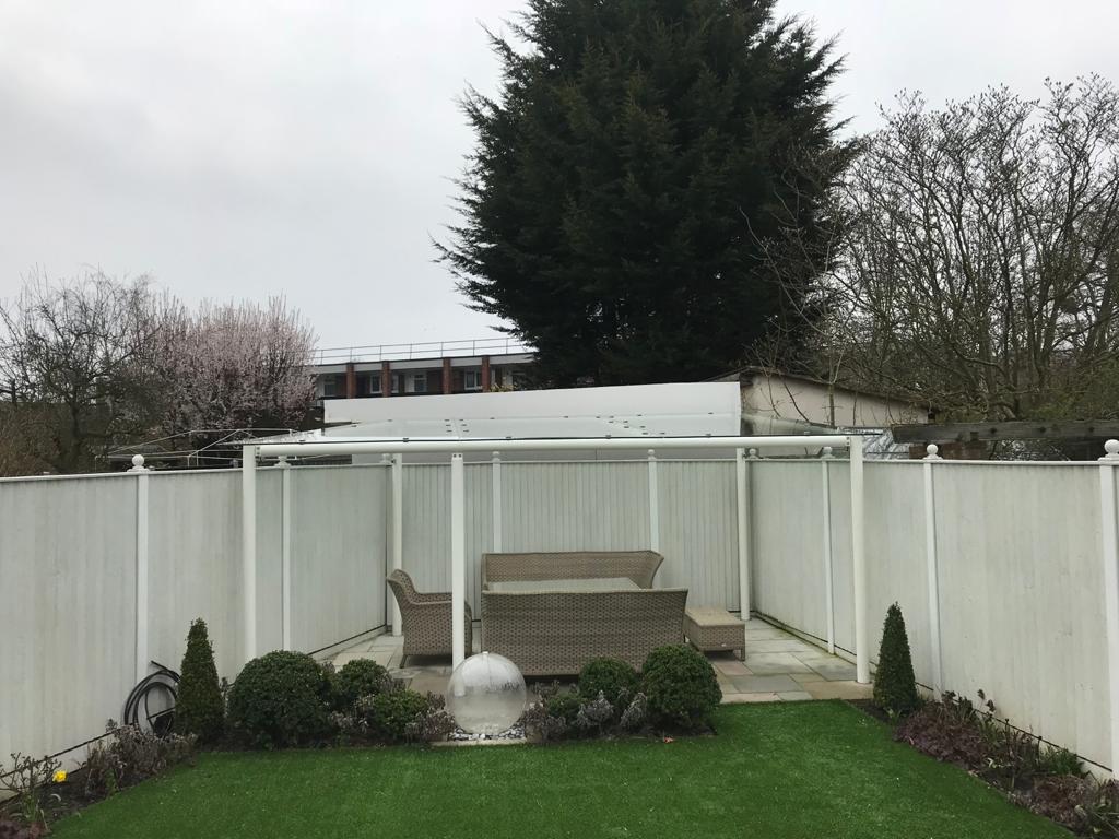 Glass garden pergola