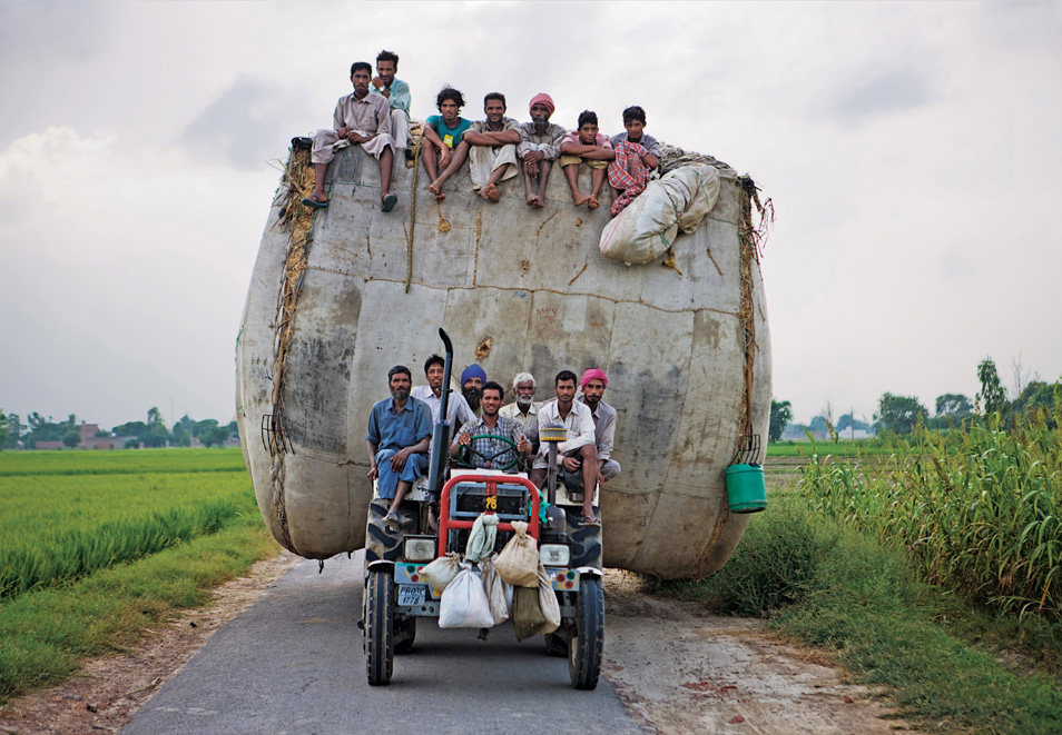Delivering animal feed in India... hey, wait a minute, aren't people hungry in India?