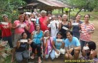 Happy farmers receive Fair Trade premium