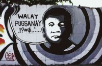 "WALL MESSAGE ""Walay pusganay"" (Don't force me) reads a message on a wall in Davao City with a sketch of Mayor Rodrigo Duterte in what seems to be an attempt to portray the tough-talking politician's statement that he should not be forced to run for President in 2016. KARLOS MANLUPIG/INQUIRER MINDANAO"
